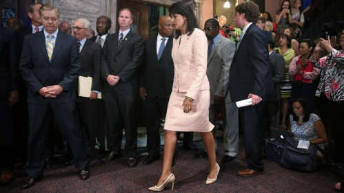 COLUMBIA, SC - JUNE 22:  South Carolina Gov. Nikki Haley arrives with other lawmakers, activists and along with Sen. Lindsey Graham (R-SC) (L) to speak with the media asking that the Confederate flag be removed from the state capitol grounds on June 22, 2015 in Columbia, South Carolina. Debate over the flag flying on the capitol grounds was kicked off after nine people were shot and killed during a prayer meeting at the Emanuel African Methodist Episcopal Church in Charleston, South Carolina.  (Photo by Joe Raedle/Getty Images)