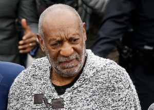 Bill Cosby arrives at court to face a felony charge of aggravated indecent assault Wednesday, Dec. 30, 2015, in Elkins Park, Pa. Cosby was charged Wednesday with drugging and sexually assaulting a woman at his home 12 years ago. (AP Photo/Matt Rourke)